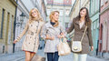 Female friends walking and laughing young Stock Photo