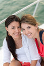Female friends on a yacht happy smiling Royalty Free Stock Photography