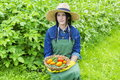 Female gardener with vegetables Royalty Free Stock Photo