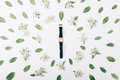 Female gold watch among green flowers and leaves Royalty Free Stock Photo