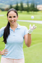 Female golf player confident at the course looking happy Stock Image