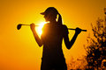 Female golfer at sunrise Royalty Free Stock Photo