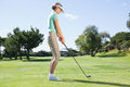 Female golfer taking a shot Royalty Free Stock Photo