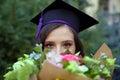 Image : Female graduate handholds image