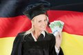 Female Graduate Student Holding Money Royalty Free Stock Photo