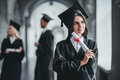 Female graduate in university Royalty Free Stock Photo