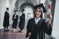 Female graduate in university Royalty Free Stock Photo