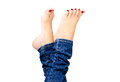 Female groomed feet in jeans beautiful with red nail polish closeup on white background Royalty Free Stock Images