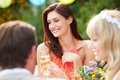 Female guest at wedding reception outdoors having a good time Royalty Free Stock Images