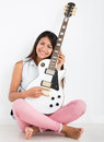 Female guitar player Stock Image