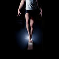 Female gymnast on balance beam standing Stock Images