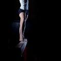 Female gymnast on balance beam standing Stock Photo