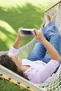 Female in hammock. Royalty Free Stock Image
