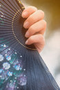 Female hand with a fan Royalty Free Stock Images