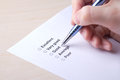 Female hand filling customer survey with pen metal Royalty Free Stock Images