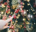 Female hand finger touching Christmas decorations Royalty Free Stock Photo