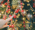 Female hand finger touching holiday ornaments Royalty Free Stock Photo