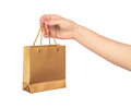 Female hand hold a gold gift bag Royalty Free Stock Photo