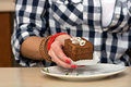 Female hand holding a chocolate cake Royalty Free Stock Photo