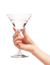 Female hand holding clean martini glass with water Royalty Free Stock Photo