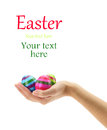 Female hand holding Easter eggs Stock Images
