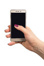 Female hand holding gold colored phone Royalty Free Stock Photo