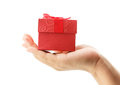 Female hand holding red gift box on white background isolated Royalty Free Stock Image
