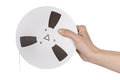 Female hand holding Tape of reel tape recorder Royalty Free Stock Photo