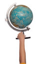 Female hand holding up a globe Stock Images