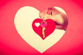 Female hand holds little heart with keys. Royalty Free Stock Photo