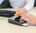 Female hand makes payment via bank terminal in office Stock Photo