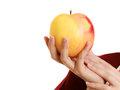 Female hand offering apple healthy fruit Royalty Free Stock Photo