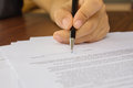 Female hand signing contract close up of business document Royalty Free Stock Photo
