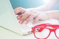 Female hand using laptop, Online shopping and business Royalty Free Stock Photo