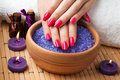 Female hands with aromatic candles and towel. Spa Stock Image