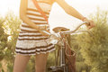 Female hands on bicycle handlebar holding retro Royalty Free Stock Image