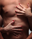 Female hands embrace a muscular male torso Royalty Free Stock Photography