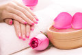 Female hands with fragrant rose petals and towel Royalty Free Stock Photography