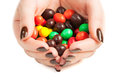 Female hands full of colored candy Stock Photo