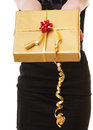 Female hands giving christmas golden gift box with ribbon. Holiday. Stock Photography