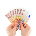 Female hands holding a fan of money Royalty Free Stock Photo