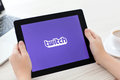 Female hands holding ipad with app twitch on the screen in the o simferopol russia june service video streaming play themes Royalty Free Stock Photos