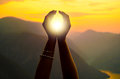 Female hands holding sun on sunny summer day Royalty Free Stock Photo