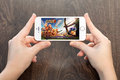 Female hands holding a white iPhone with Clash of clans on the s Royalty Free Stock Photo