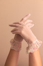 Female hands modeling vintage lace gloves Royalty Free Stock Photo