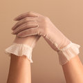 Female hands modeling vintage sheer gloves image of woman s forearms and see through Royalty Free Stock Photo