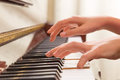 Female hands playing piano Royalty Free Stock Photo