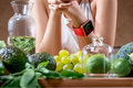 Female hands with smart watch and green fruits Royalty Free Stock Photo