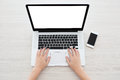 Female hands typing on a laptop keyboard Royalty Free Stock Photo