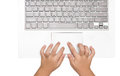 Female hands using laptop. business girl using touchpad on white Royalty Free Stock Photo
